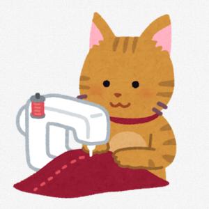 ミシンを使う猫